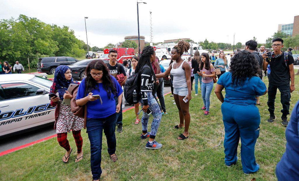 Students evacuate a building at North Lake College.