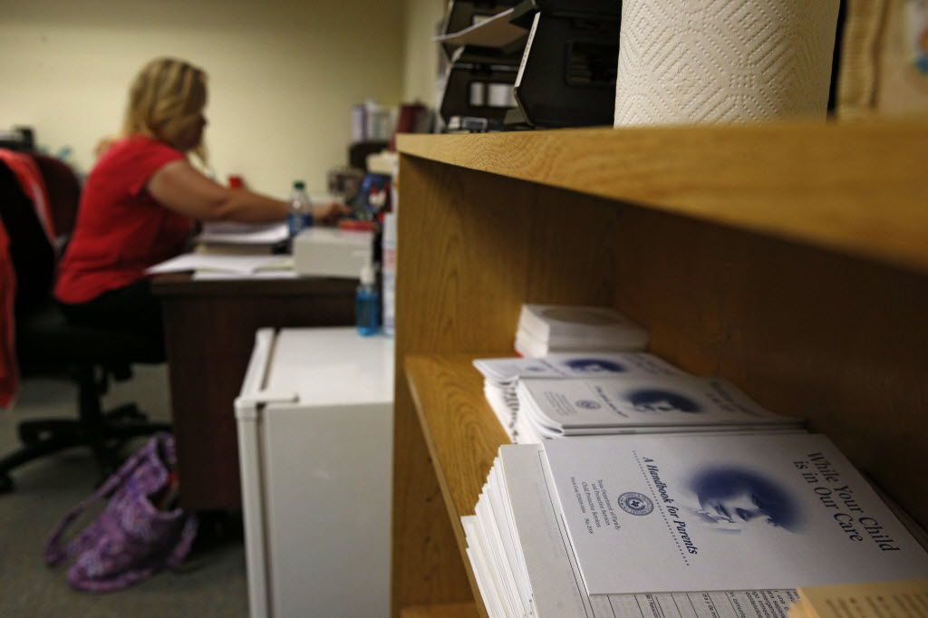 A Child Protective Services child-abuse investigator caught up on paperwork at her Fort Worth office in June.