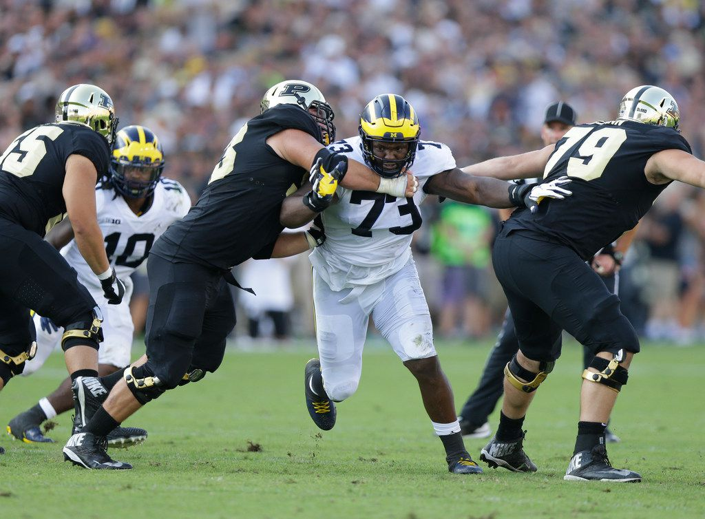 FILE - In this Sept. 23, 2017, file photo, Michigan defensive lineman Maurice Hurst (73) fights against Purdue offensive lineman during an NCAA college football game in West Lafayette, Ind. (AP Photo/Michael Conroy, File)