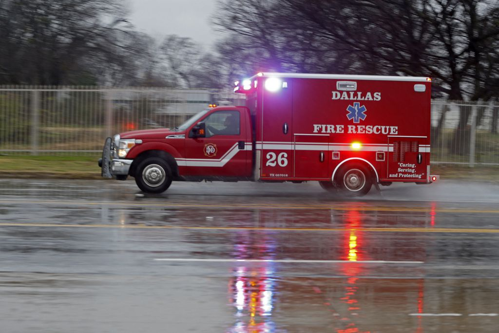 A Dallas Fire-Rescue ambulance heads off to a call on a cold rainy morning in Dallas on Jan. 2, 2019.  (Nathan Hunsinger/The Dallas Morning News)