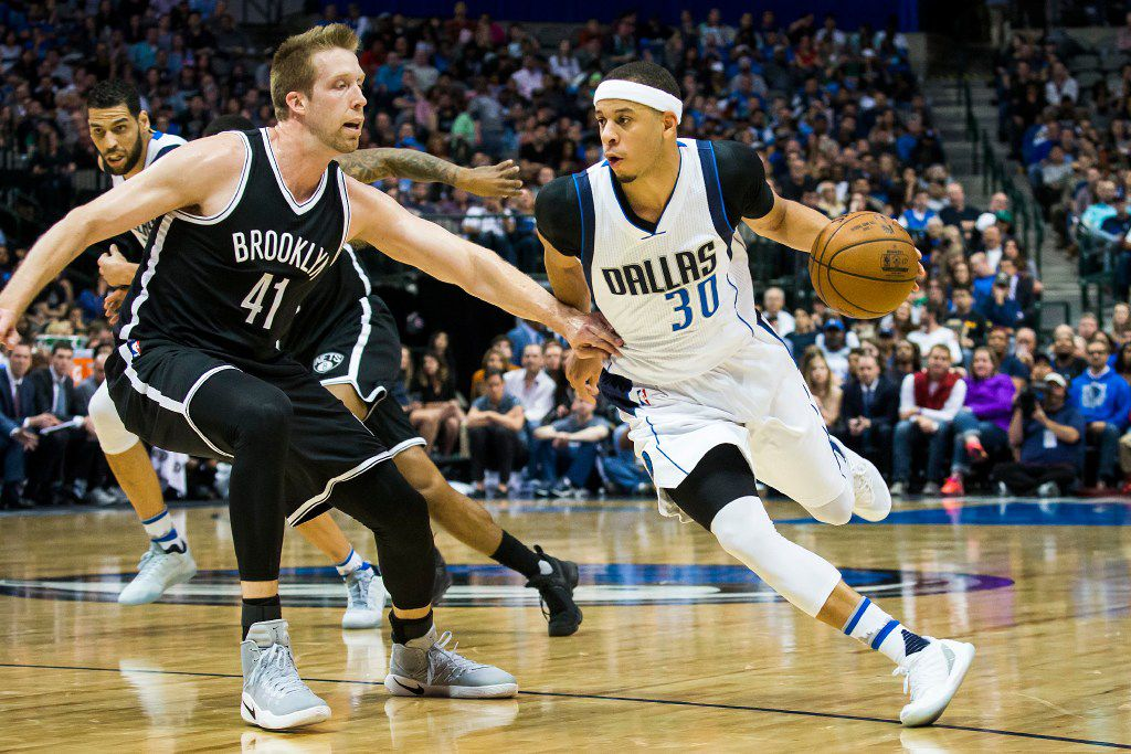 Dallas Mavericks guard Seth Curry (30) drives around Brooklyn Nets center Justin Hamilton (41) during the second half of an NBA basketball game at American Airlines Center on Friday, March 10, 2017, in Dallas. (Smiley N. Pool/The Dallas Morning News)