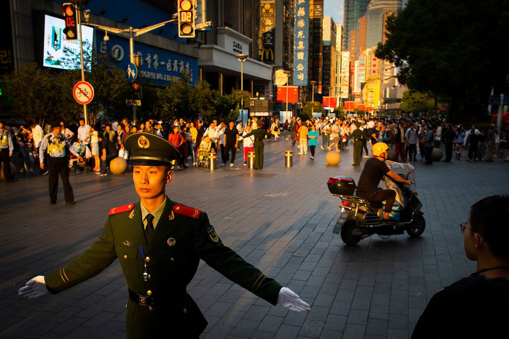 To keep the crowds out of traffic, soldiers were stationed every few meters on East Nanjing Road. Eventually, this area turned into a pedestrian-only mall lined with shops. At the end of the mall, I kept walking under a highway underpass and the crowds thinned out as I approached the trees of People's Square.