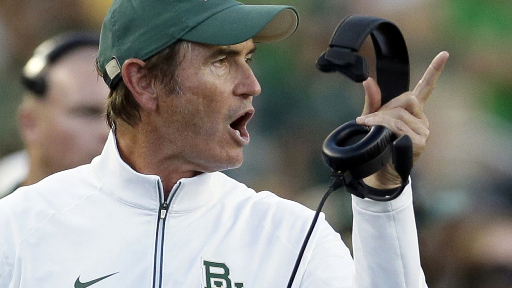 FILE - In this Sept. 12, 2015, file photo, Baylor coach Art Briles yells from the sideline during the first half of an NCAA college football game against Lamar in Waco, Texas. Briles is accusing Baylor of wrongful termination and indicating he has no interest in settling a federal lawsuit filed against him and the university by a woman who was raped by a football player, according to a motion filed Thursday, June 16, 2016, as part of the lawsuit. Briles says he wants a judge to assign him new attorneys and his personal legal team is demanding that Baylor turn over all its files in the sexual assault scandal that has gripped the Baptist university for months. (AP Photo/LM Otero, File