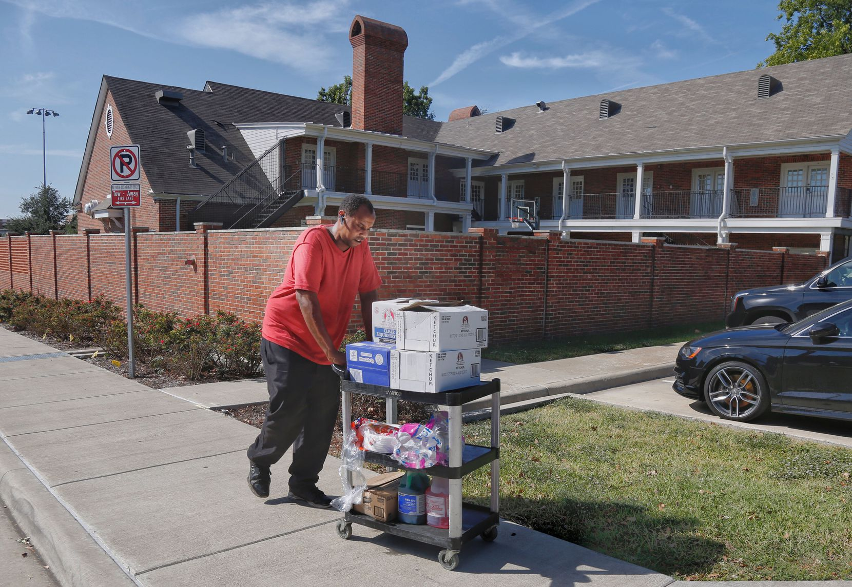 A worker who asked not to be identified removes food items from the Kappa Alpha house on the SMU campus in Dallas, Texas Thursday October 6, 2017.