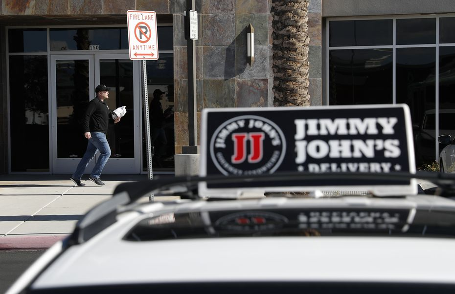 "Tyler Schwecke makes a delivery for Jimmy John's. The company has long advertised its ""freaky fast"" delivery."