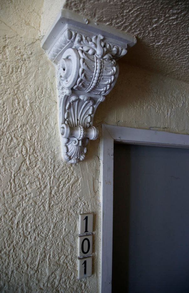 An architectural flourish above the door to the front unit is seen in the Bella Villa apartments in Vickery Place.