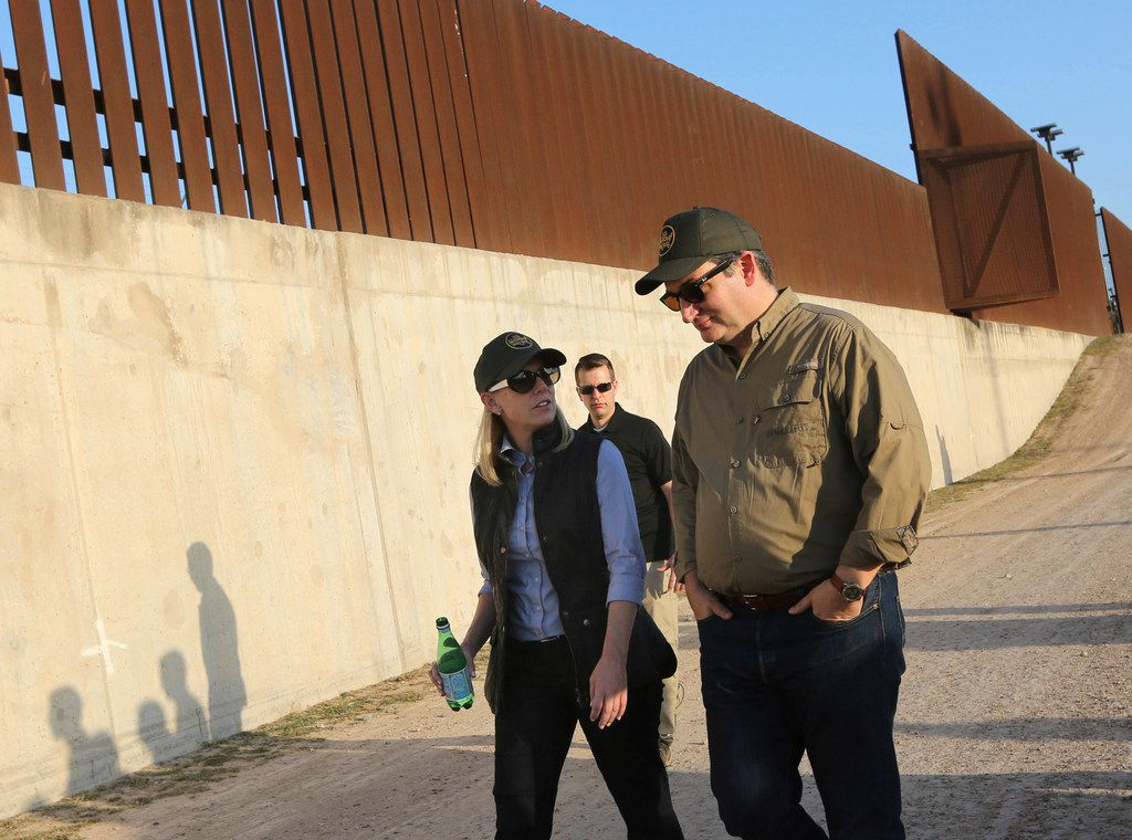 Sen. Ted Cruz, right, walks with Homland Security Secretary Kirstjen Nielsen while touring the border wall Friday, Feb. 16, 2018, in Hidalgo, Texas. Cruz and Nielsen accompanied Vice President Mike Pence as they spent the afternoon touring the U.S.-Mexico border talking with federal law enforcement officers on their efforts to secure the border. (Nathan Lambrecht/The Monitor via AP)