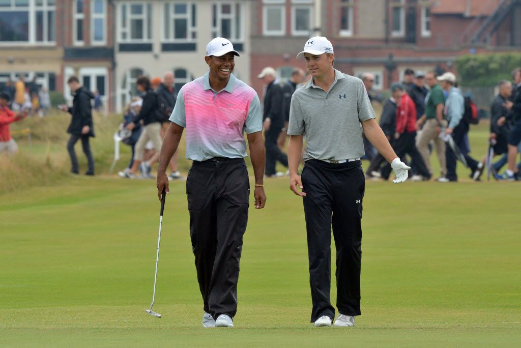 US golfer Jordan Spieth (L) and US golfer Tiger Woods share a joke on the 3rd green during their third rounds, on day three of the 2014 British Open Golf Championship at Royal Liverpool Golf Course in Hoylake, north west England on July 19, 2014. AFP PHOTO / PAUL ELLISPAUL ELLIS/AFP/Getty Images 08032014xSPORTS 07122015xSPORTS