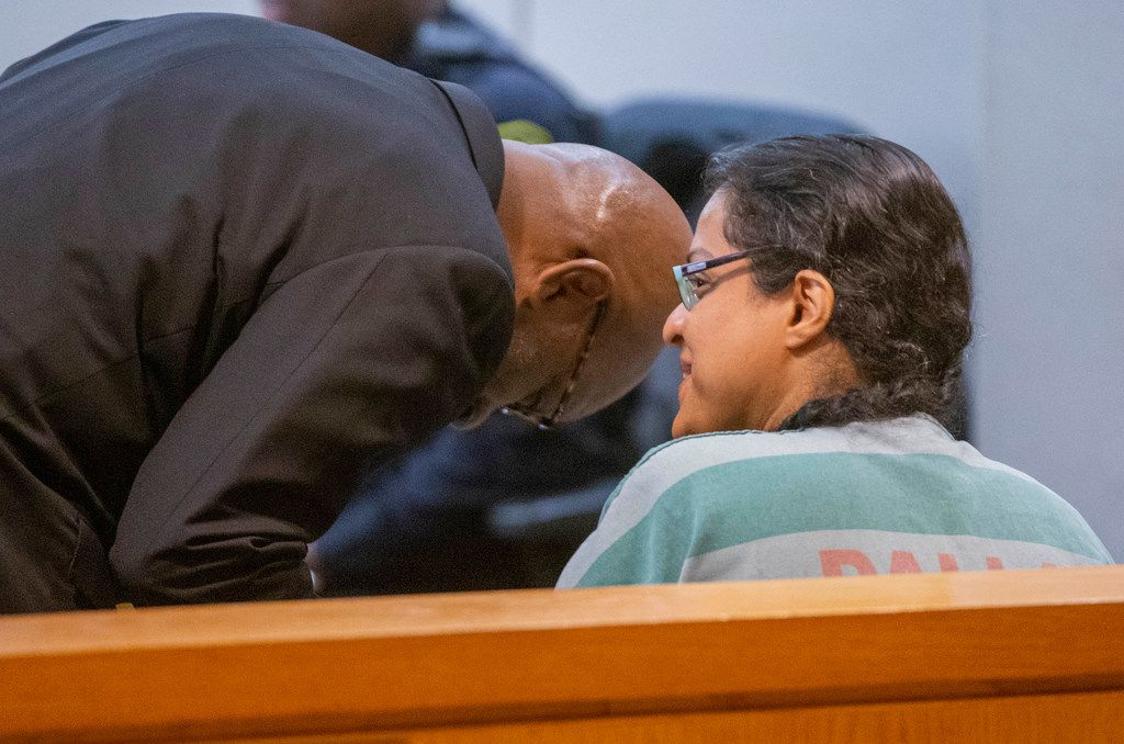 Lawyer Philip B. Parker talked to client Sini Mathews during a bond reduction hearing at the Frank Crowley Courts Building in January.