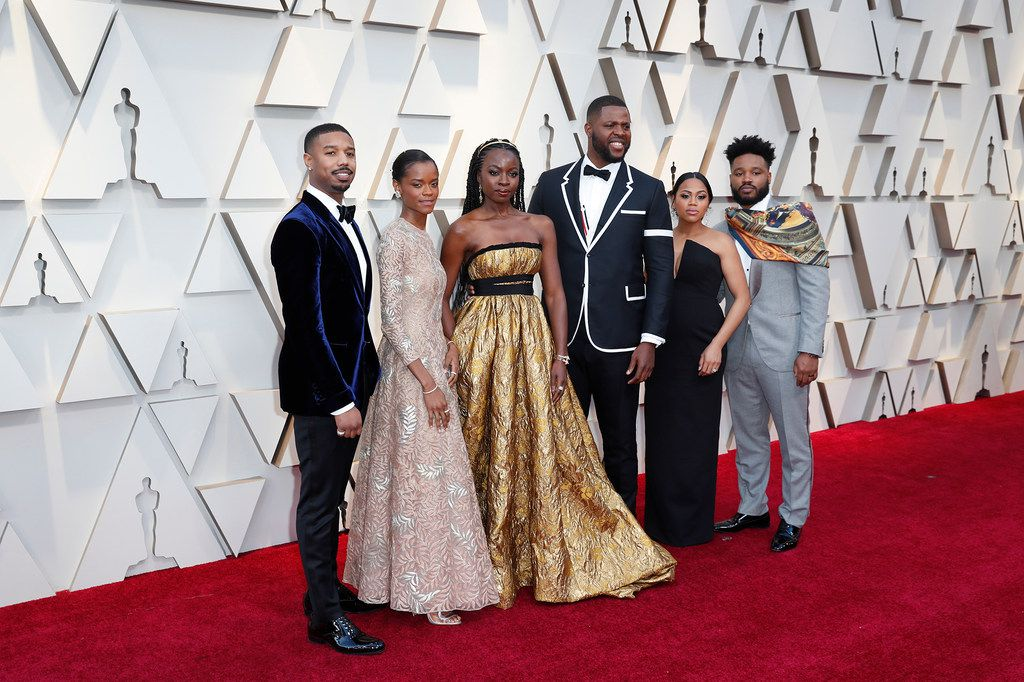 Black Panther cast members (from left) Michael B. Jordan, Letitia Wright,     Danai Gurira, Winston Duke, Zinzi Evans (wife of director Ryan Coogler) and director Ryan Coogler during arrivals at the 91st Academy Awards on Sunday.