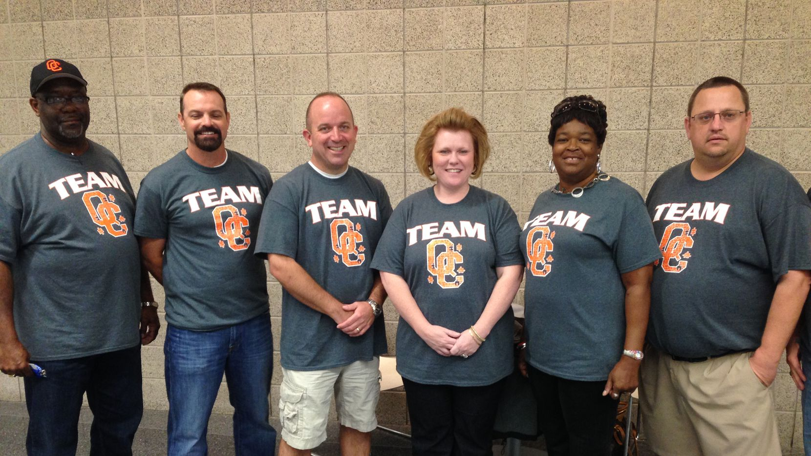 "Members of the Queen City ISD school board posed for DallasNews.com Watchdog Dave Lieber at the 2014 Texas Association of School Boards convention in Dallas. A state senator describes the non-profit's training as ""indoctrination."" The wearing of ""Team"" t-shirt illustrates what she called ""a kind of culture."""