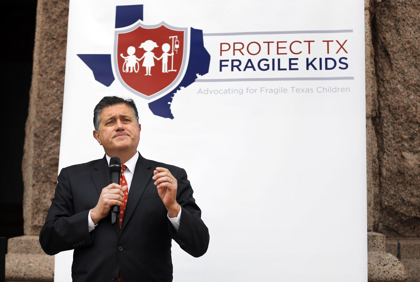 Texas Rep. Richard Raymond D-Laredo speaks to those gathered for a rally hosted by Protect Fragile TX Children outside the Texas State Capitol, Tuesday, February 26, 2019.