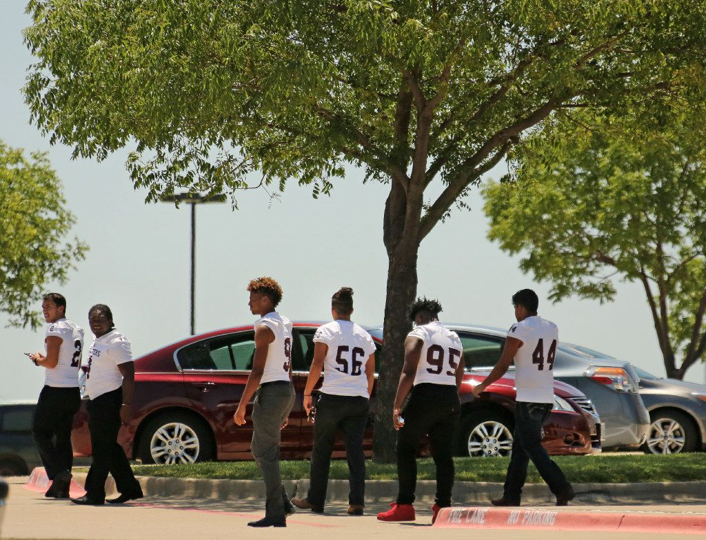 Mesquite High football players leave Saturday's memorial service for Jordan Edwards, who played football at the school.