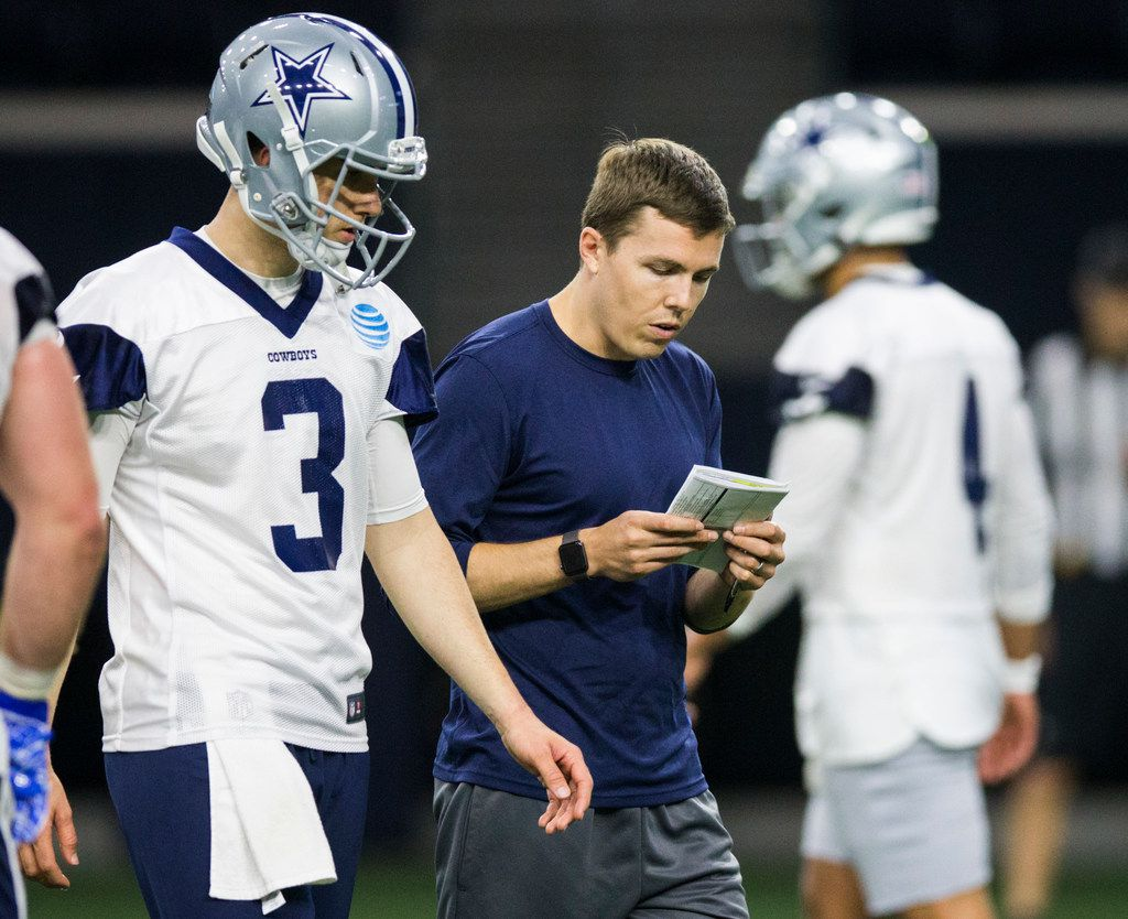 Dallas Cowboys offensive coordinator Kellen Moore talks to quarterback Mike White (3) during a Dallas Cowboys OTA practice on Wednesday, May 29, 2019 at The Star in Frisco. (Ashley Landis/The Dallas Morning News)