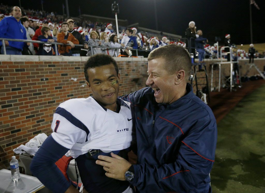 Allen quarterback Kyler Murray (1) is congratulated by head coach Tom Westerberg just before winning the UIL class 6A division I state semifinal high school football game between Allen and Skyline at Gerald J. Ford Stadium in Dallas Saturday December 13, 2014. Allen beat Skyline 52-34. (Andy Jacobsohn/The Dallas Morning News)