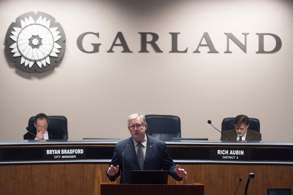 Garland Mayor Douglas Athas reads from his resignation letter before the start of the city council meeting on Tuesday, Jan. 9, 2018.  (Rex C. Curry/Special Contributor)