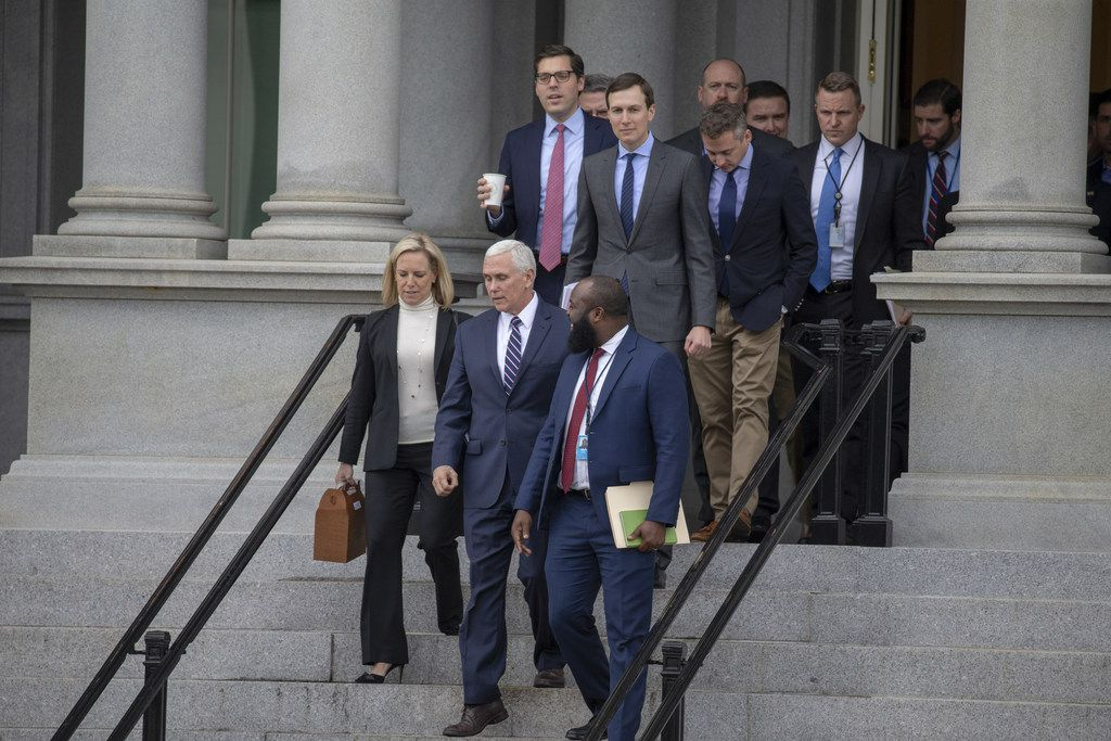 WASHINGTON, DC - JANUARY 05: (AFP OUT) (L-R)  Secretary of Homeland Security Kirstjen Nielsen, White House Senior Adviser Jared Kushner Vice President Mike Pence and Ja'Ron Smith special assistant to the President of the United States exit the Eisenhower Executive Office Building on January 05, 2019 in Washington, DC. The U.S government is going into the third week of a partial shutdown with Republicans and Democrats at odds on agreeing with President Donald Trump's demands for more money to build a wall along the U.S.-Mexico border. (Photo by Tasos Katopodis/Getty Images)