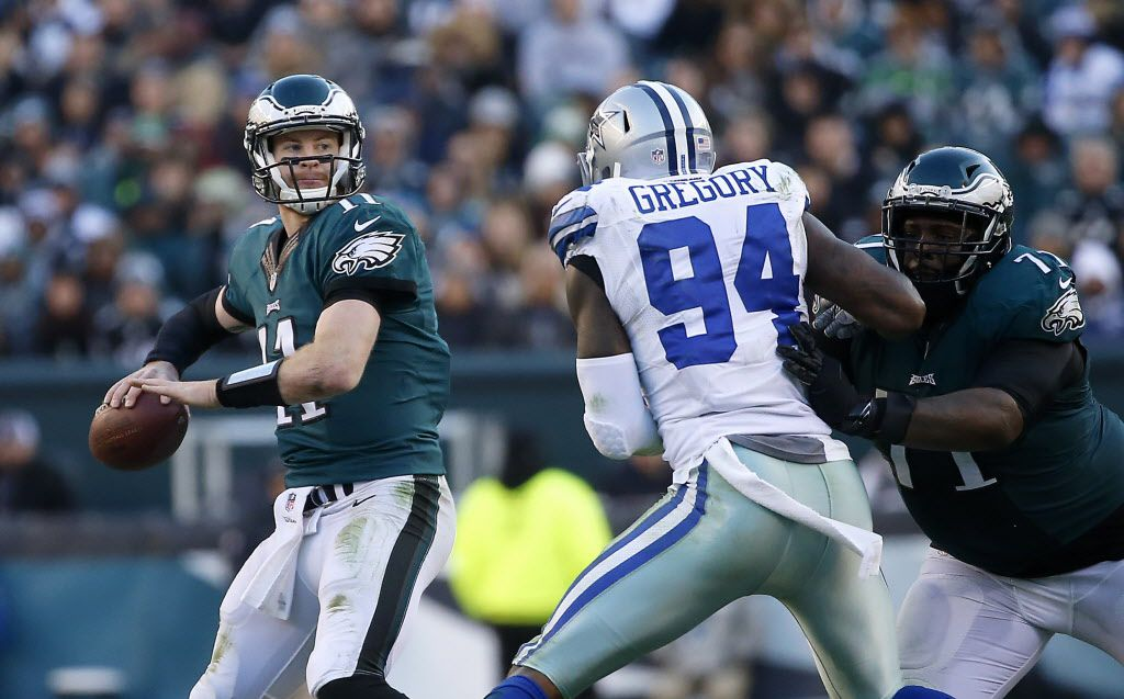 Philadelphia Eagles quarterback Carson Wentz (11) looks up to pass the ball as Dallas Cowboys defensive end Randy Gregory (94) is blocked by Philadelphia Eagles tackle Jason Peters (71) during the fourth quarter at Lincoln Financial Field in Philadelphia, Sunday, Jan. 1, 2017. The Dallas Cowboys lost 27-13. (Jae S. Lee/The Dallas Morning News)