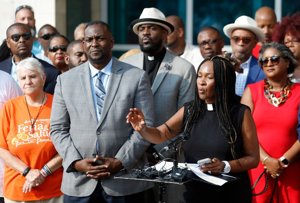 Dr. Sheron Patterson of Hamilton Park United Methodist Church speaks as the African-American Pastors Coalition showed their support for Dallas Police Chief U. Reneé Hall outside the Dallas Police Department Headquarters in Dallas on Friday.