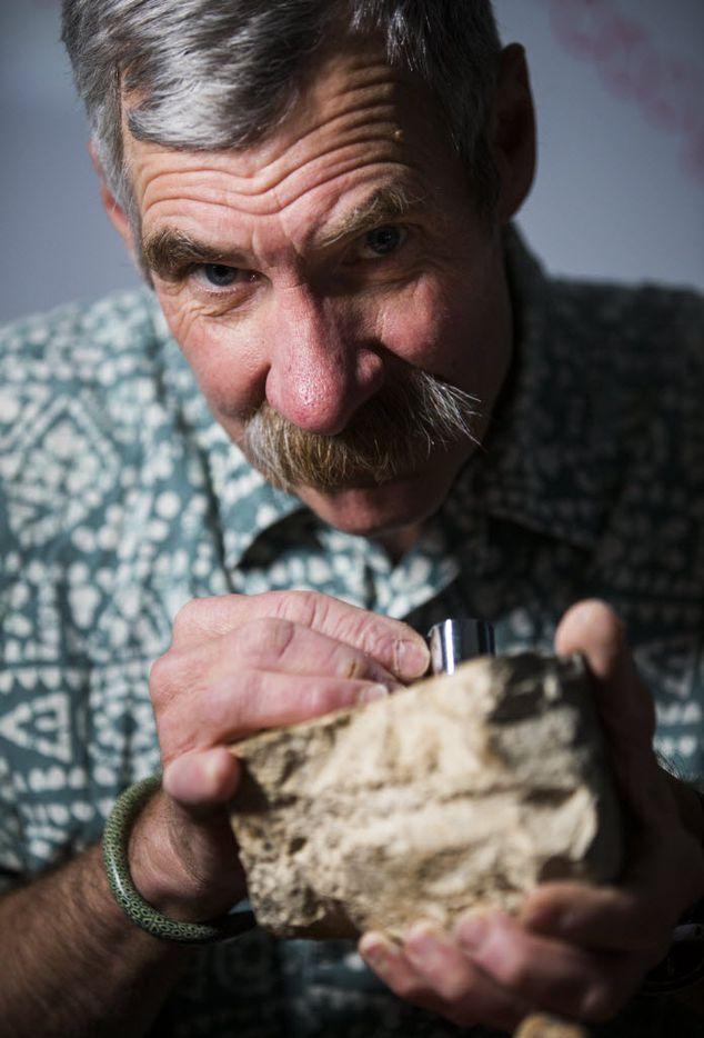 John Geissman, UTD professor of geosciences, with a rock donated by John Tackle.