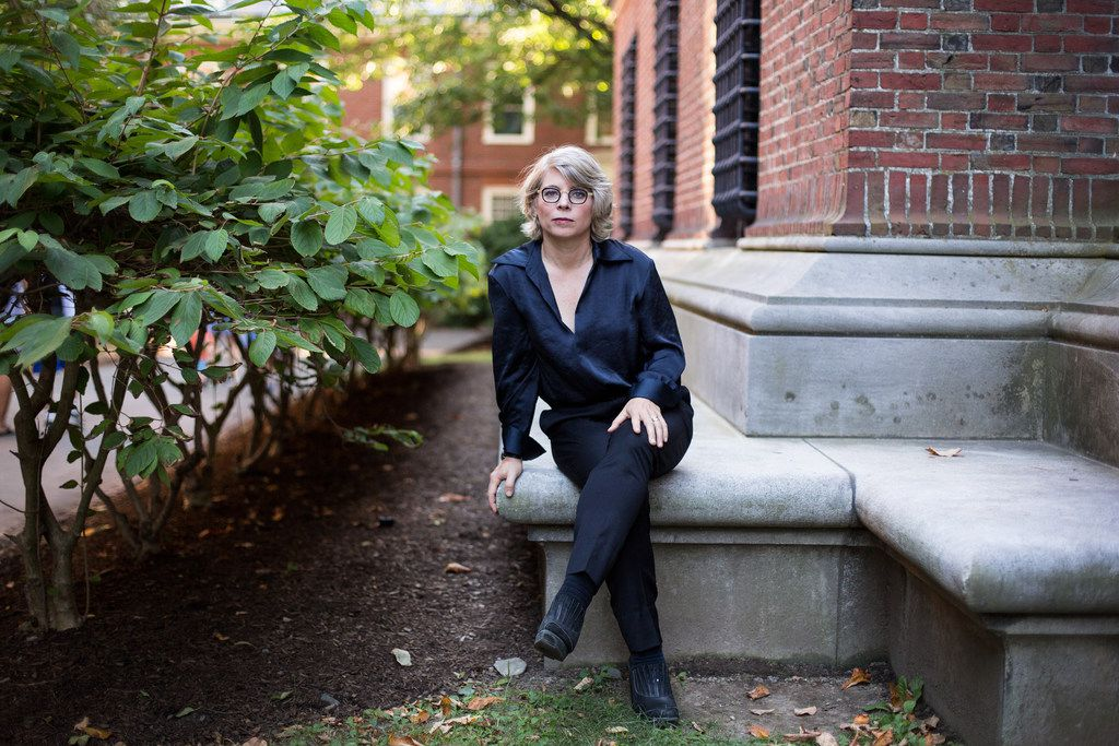 Historian and author Jill Lepore sits outside the Widener Library at Harvard University on Sept. 5, 2018. In her new book, These Truths: A History of the United States, Lepore starts with Columbus's arrival and wends her way through the next five centuries.