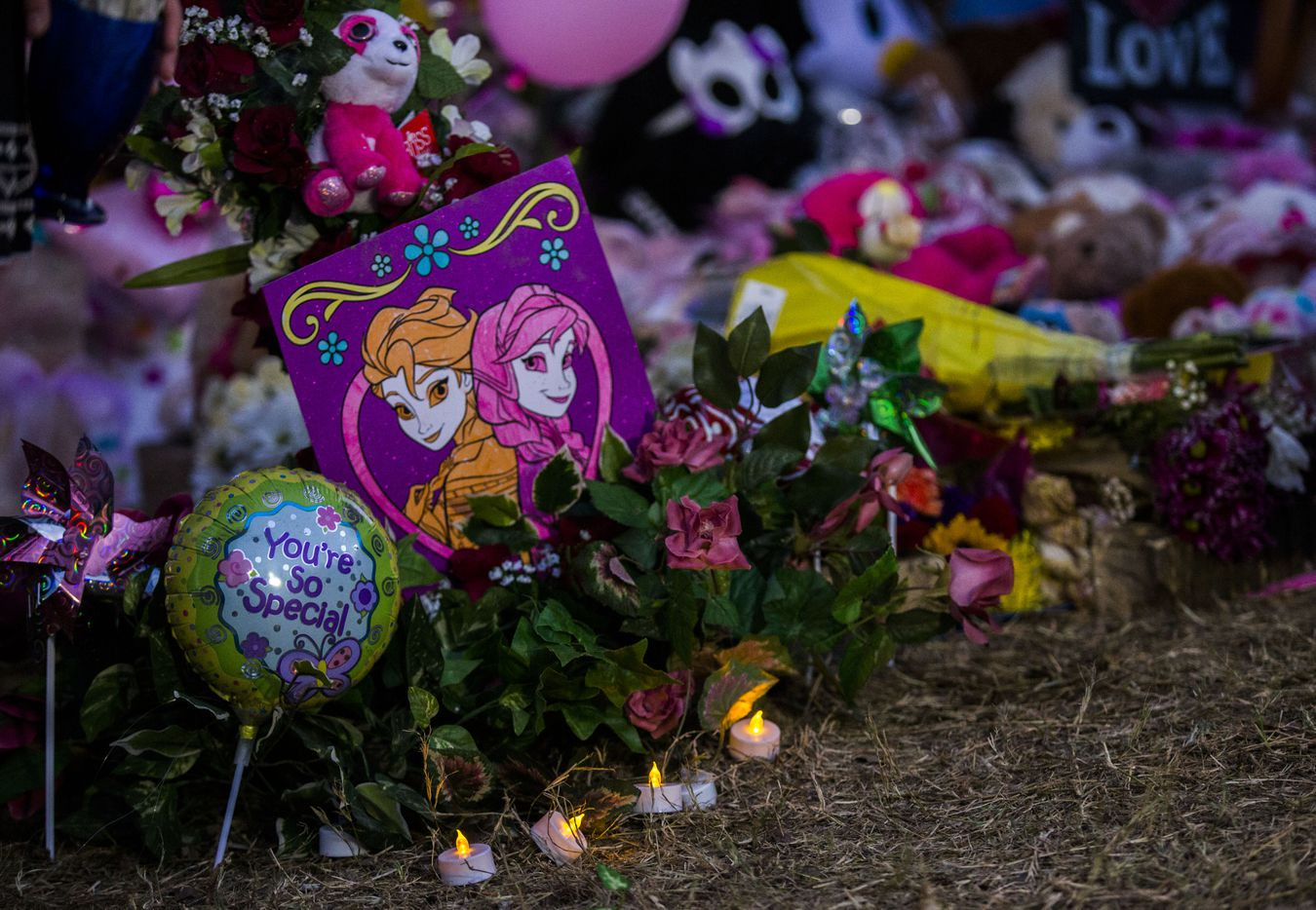 Signs, flowers, balloons and other items collect at a memorial for missing 3-year-old Sherin Mathews.