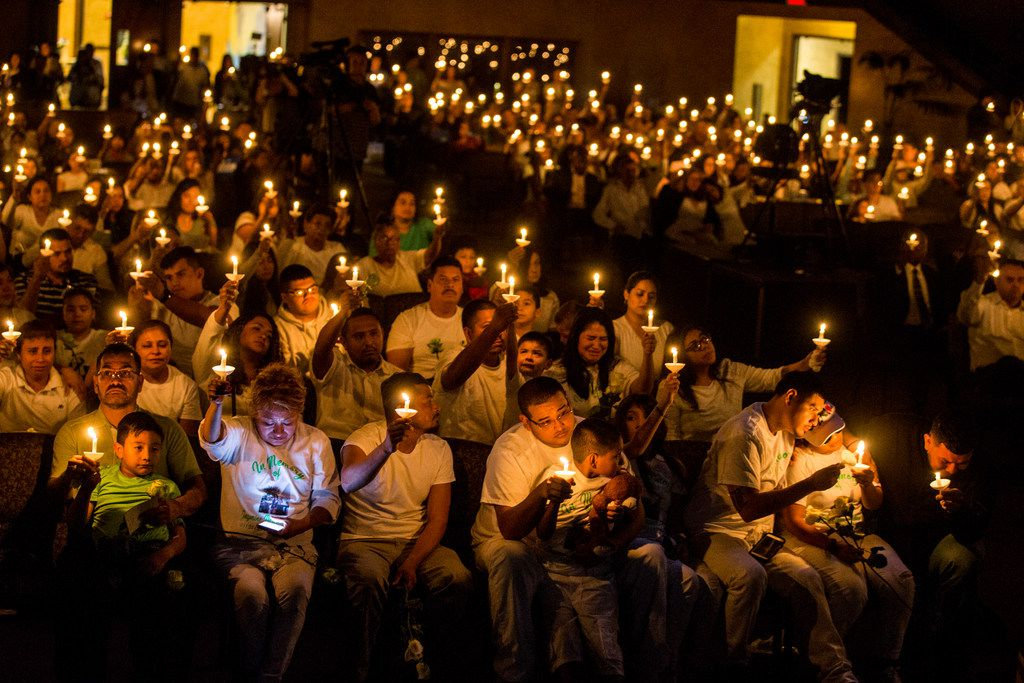 Magaly Villarreal, bottom right, mother of Jazmine Alfaro, along with other mourners gather during a candlelight vigil for Jazmine Alfaro at Family Cathedral of Praise in Mesquite on Oct. 6, 2018. Jazmine Alfaro died in a school bus crash on Wednesday.