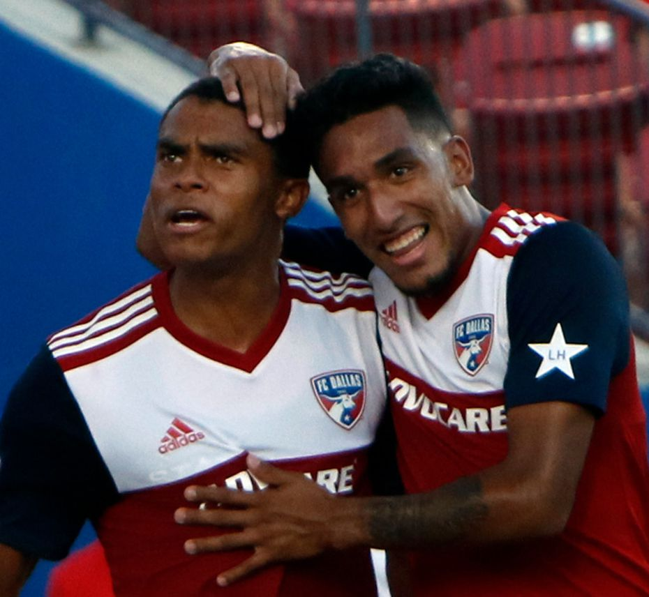 FC Dallas defenseman Reggie Cannon (2), left, is congratulated by teammate Jesus Ferreira (27) following Cannon's tie splitting goal late in the first half of play against Minnesota United FC. The two MLS teams competed in their match which was held at Toyota Stadium in Frisco on August 10, 2019. (Steve Hamm/ Special Contributor)