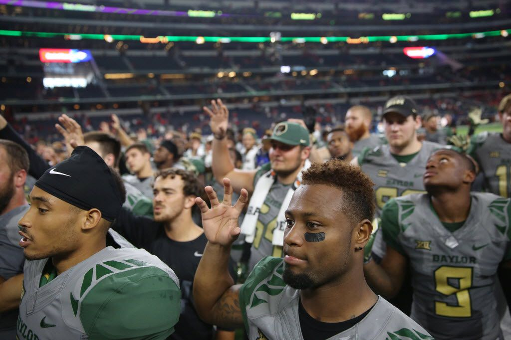 Baylor Bears running back Shock Linwood (32), bottom center, participates in the school song following an NCAA football game between Texas Tech and Baylor at AT&T Stadium in Arlington, Texas Saturday October 3, 2015. (Andy Jacobsohn/The Dallas Morning News)
