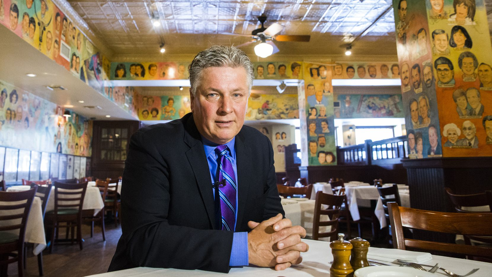Al Biernat, former manager of The Palm restaurant, poses for a portrait among the restaurant's signature caricatures on Tuesday, June 20, 2017 at The Palm in downtown Dallas. Most of the caricatures were created by artist Bill Lignante. The restaurant will close it's doors on June 30. (Ashley Landis/The Dallas Morning News)