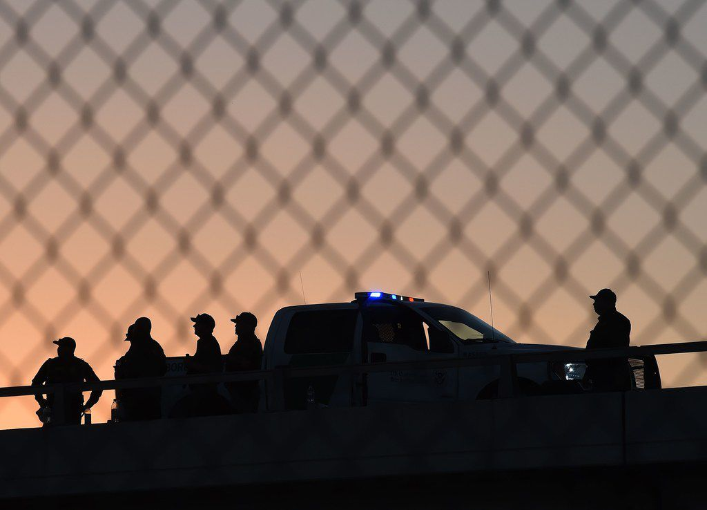 U.S. Border Patrol officers guard the fence separating US and Mexico in El Paso in 2016.