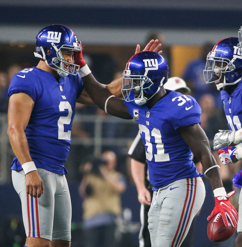 FILE - New York Giants kicker Aldrick Rosas (2) and defensive back Michael Thomas (31) celebrate a play during a matchup between the Dallas Cowboys and the New York Giants on Sunday, Sept. 16, 2018 at AT&T Stadium in Arlington, Texas. (Ryan Michalesko/The Dallas Morning News)