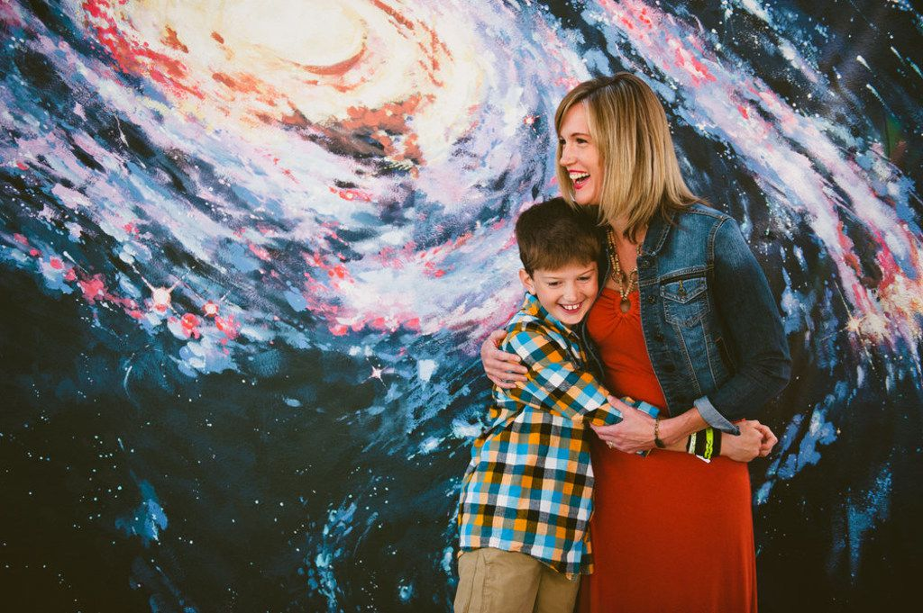 Amber Briggle hugs her 10-year-old transgender son Max.