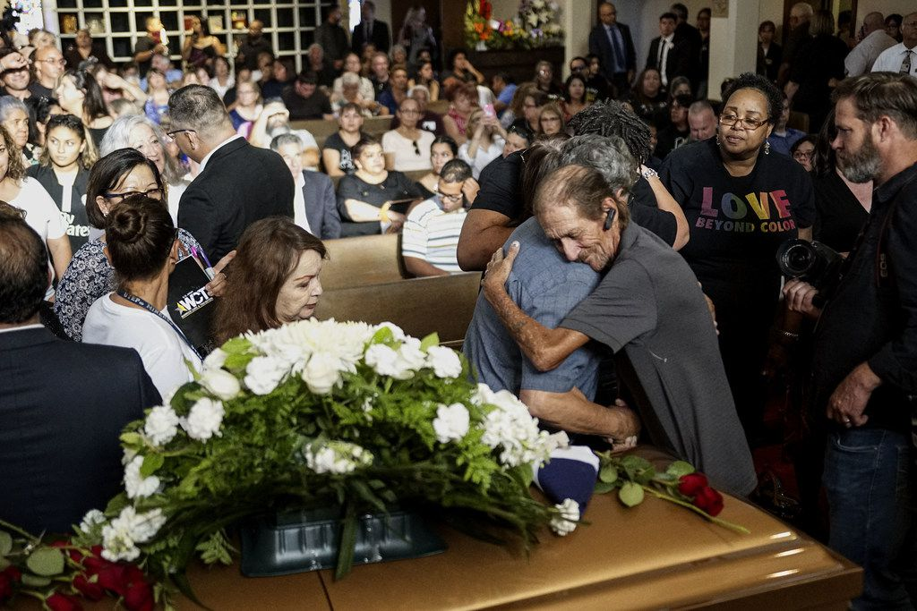 Antonio Basco greets well wishers to a public memorial for his wife, Margie Reckard, on August 16, 2019 in El Paso, Texas. Reckard was one of 22 killed during the Walmart shooting in El Paso on August 3rd. Basco invited the public to attend the memorial in her honor and has laid fresh flowers everyday since the shooting at a make-shift memorial outside the outlet.