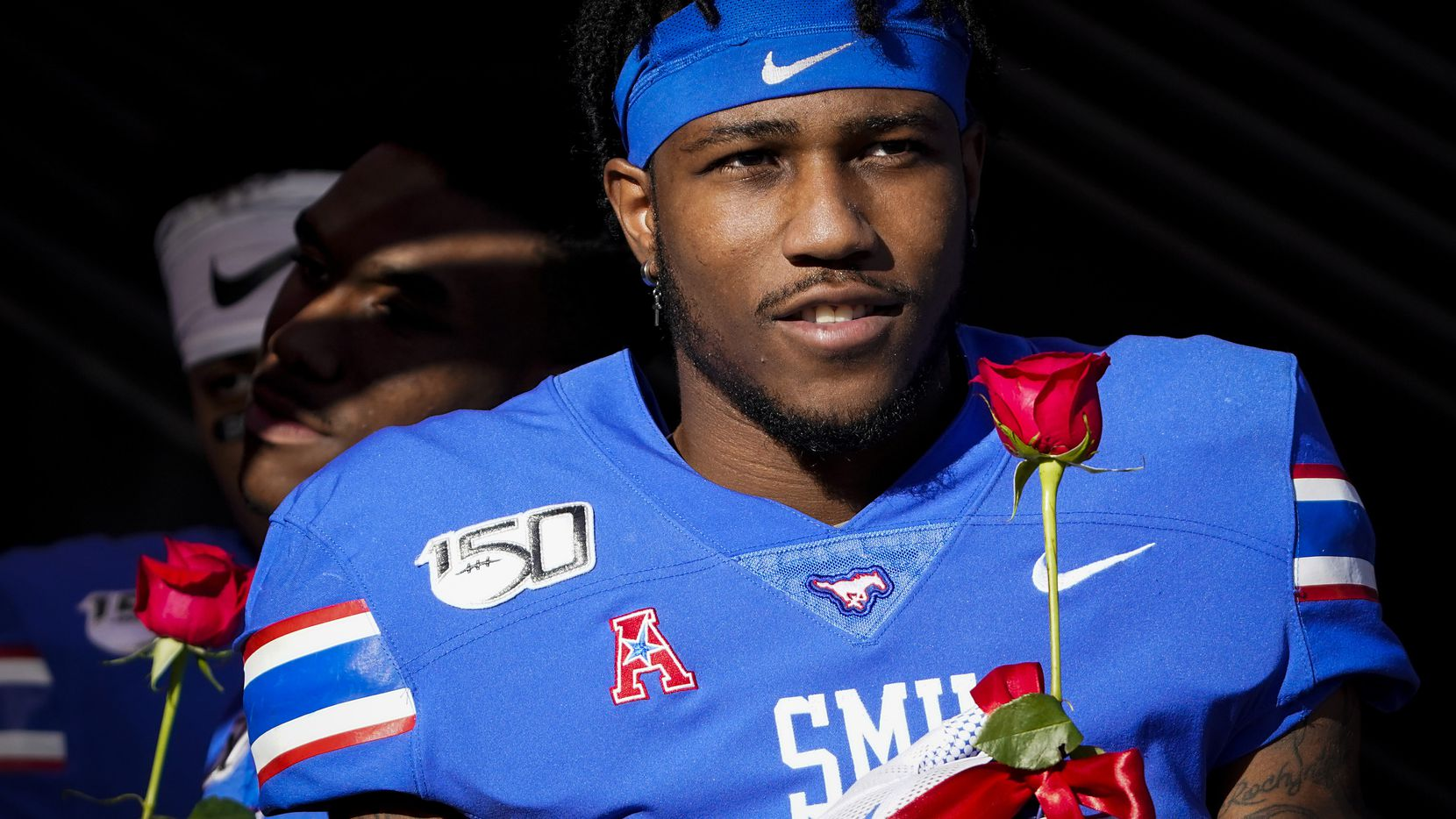 SMU cornerback Robert Hayes Jr. carries a rose onto the field during senior day activities before an NCAA football game against Tulane at Ford Stadium on Saturday, Nov. 30, 2019, in Dallas.