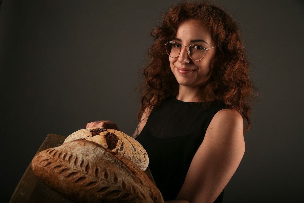 Brooke Carter of Rosemary Bakery with loaves of fresh sourdough bread