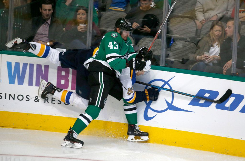 Dallas Stars right wing Valeri Nichushkin (43) checks St. Louis Blues defenseman Colton Parayko (55) during the third period of their hockey game at American Airlines Center in Dallas on Sept. 18, 2018. Dallas Stars won the game 5-3. (Nathan Hunsinger/The Dallas Morning News)