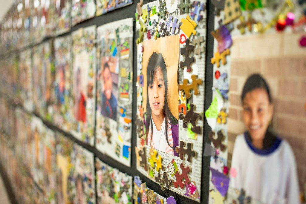 Pictures of DISD refugee summer program participants hang in the hallway at Sam Tasby Middle School in Dallas on Wednesday, June 26, 2019.