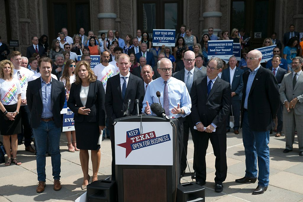 Jeff Moseley, with Texas Association of Business, joins other Texas business and tourism representatives who gathered on the south steps of the state capitol on Monday July 17, 2017 to urge lawmakers not to approve bills to regulate transgender bathroom access. They contend such laws would be discriminatory and have a negative impact on the state's economy. (Ralph Barrera/Austin American-Statesman via AP)