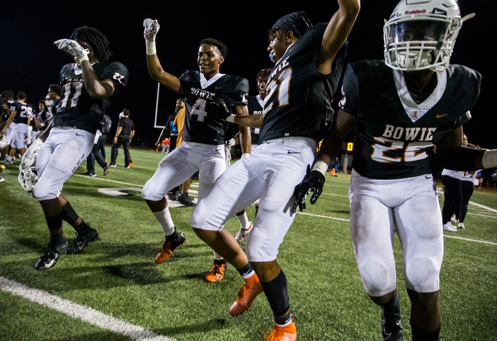 Arlington Bowie football players celebrate after a 28-14 win over Flower Mound Marcus on Thursday, August 29, 2019 at Wilemon Field in Arlington. (Ashley Landis/The Dallas Morning News)
