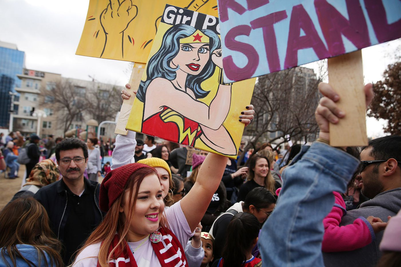 Marchers arrive at at Pike Park before the rally portion of the Dallas Women's March in Dallas Saturday.