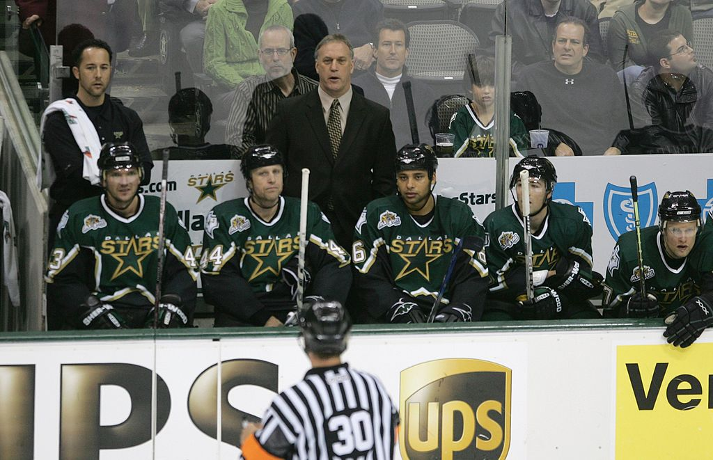 DALLAS - DEC. 6, 2006:  Associate Coach Rick Wilson of the Dallas Stars talks with the referee against the Phoenix Coyotes during the NHL game on December 6, 2006 at the American Airlines Center in Dallas.  (Photo by Bruce Bennett/Getty Images)