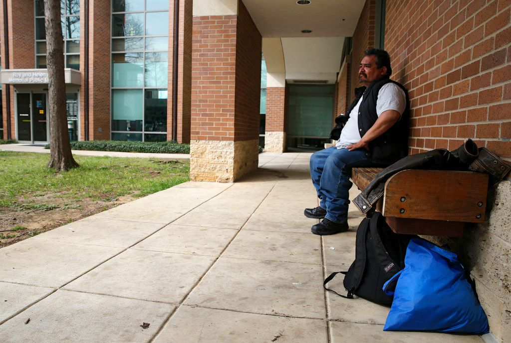Pedro Garza of McKinney sits on a bench outside of the Roy and Helen Hall Public Library in McKinney, on Friday, March 22, 2019. Garza, who is homeless, has been camping out at the library for about a month.