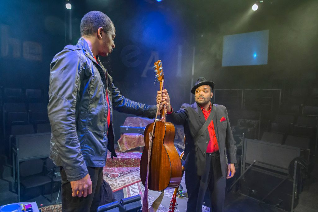 Darren McElroy (left) plays Youth, and Calvin Scott Roberts plays Narrator (the older version of Youth) in  Passing Strange,  the autobiographically inspired 2008 Broadway musical by Stew and his longtime collaborator Heidi Rodewald, at Theatre Three in Dallas.