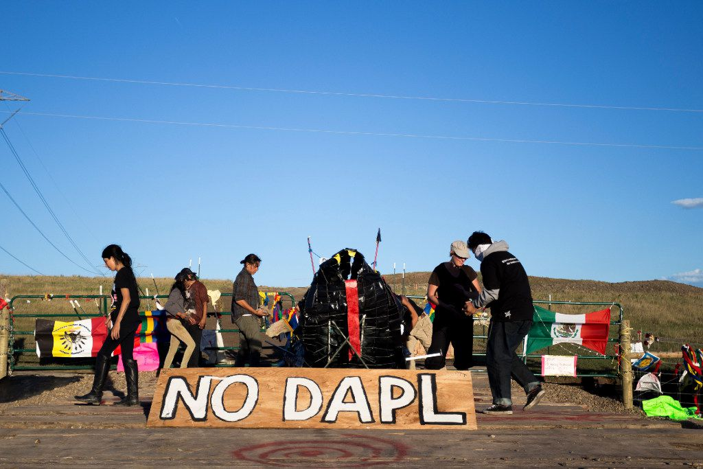 A group of people set a black snake sculpture on Sacred Burial Grounds in Cannonball North Dakota on Sunday Sep 18th, 2016. Native american  believe in the pipeline as a black snake from  an old Lakota prophecy that the black snake will bringing with it destruction and devastation. Construction has been halted after the Obama administration decision to suspend construction on a controversial oil pipeline in North Dakota.  (Jeenah Moon/Special Contributor)