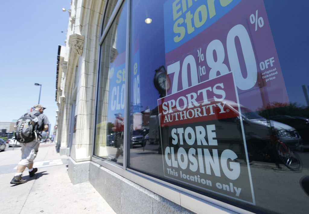 A shopper heads into the flagship location of retailer Sports Authority south of downtown Denver Friday, June 17, 2016. The store will close Sunday after serving as a site for a sports equipment retailer for decades as the bankrupt retailer shuts its doors at all locations across the country. (AP Photo/David Zalubowski)