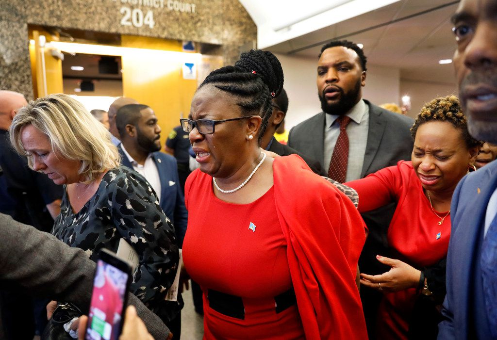 """Botham Jean's mother, Allison, leaves the 204th District Court after fired Dallas police Officer Amber Guyger was found guilty of murder Tuesday. She repeatedly said, """"God is good. Trust him,"""" as she left the courtroom."""
