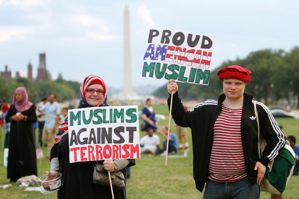 People hold banners during the Americans Against Terrorism, Hate and Violence rally on the National Mall in Washington on July 23.