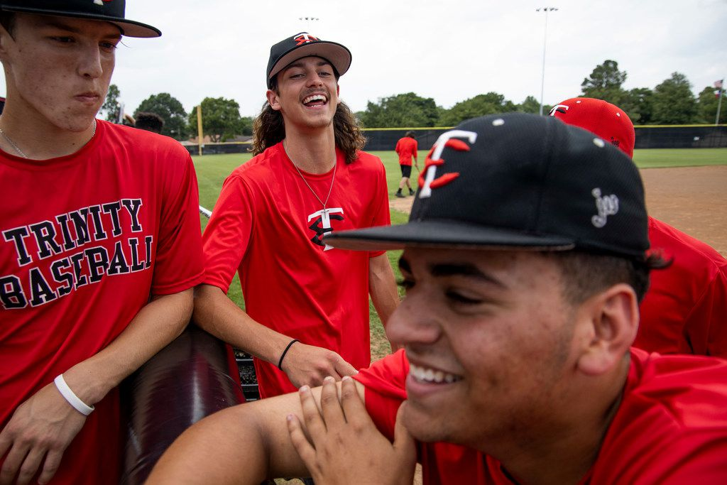 Chase Dickens listens as Luke Crow and Nick Fort share a moment during baseball practice at Euless Trinity High School in Euless, Texas Wednesday, May 22, 2019. (Shaban Athuman/Staff Photographer)