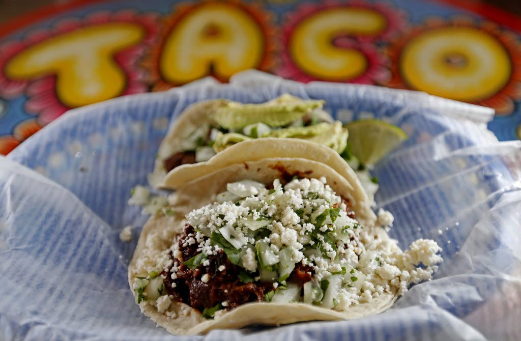 Two tacos, Puerco Verde (front) and Carne Asada, at Tacodeli in Sylvan Thirty
